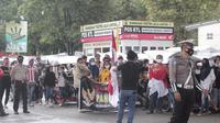 Ratusan massa aksi yang mengendarai Becak Motor (Bentor) di Kabupaten Gorontalo (Kabgor) kembali menolak kedatangan Pimpinan Front Pembela Islam (FPI) Habib Rizieq Shihab. (Arfandi Ibrahim/Liputan6.com)