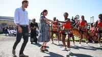 Meghan Markle dan Pangeran Harry saat tur kerajaan di Afrika Selatan. (Betram MALGAS / POOL / AFP)