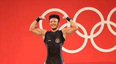 Lifter Indonesia Rahmat Erwin Abdullah saat berlaga di Olimpiade Tokyo 2020