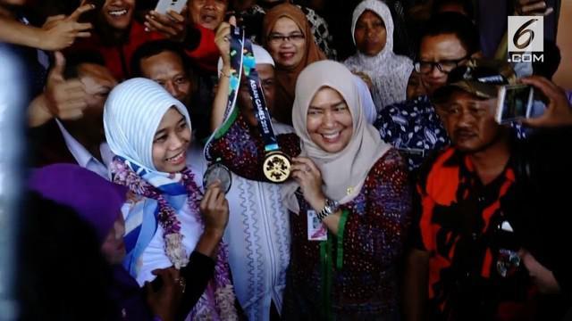 Usai meraih emas dan perak dalam Asian Games Atlet panjat tebing putri Puji Lestari disambut meriah oleh warga Marunda kampung asal Puji.