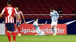 Kemenangan di depan mata Atletico Madrid buyar menyusul gol telat Celta Vigo di menit akhir babak kedua melalui Facundo Ferreyra. (AP Photo/Jose Breton)