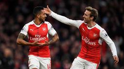 Pemain Arsenal, Theo Walcott, merayakan golnya ke gawang AFC Bournemouth dalam laga pekan ke-13 Premier League 2016-2017 di Stadion Emirates, Minggu (27/11/2016). (Action Images via Reuters/Tony O'Brien)