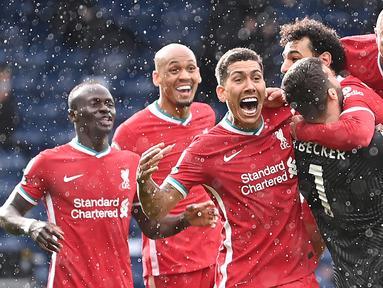 Liverpool merupakan satu-satunya klub di Liga Inggris yang belum pernah mencicipi kekalahan hingga pekan ini. The Reds sukses mengoleksi 15 poin dari 4 kemenangan dan 3 kali seri. Skuat asuhan Juergen Kopp tersebut saat ini menempati urutan kedua klasemen sementara. (AFP/Pool/Laurance Griffiths)