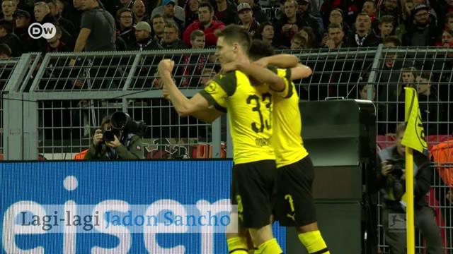 Berita video gol spektakuler yang dicetak mantan pemain Manchester City, Jadon Sancho yang kini menjelma menjadi bintang di Borussia Dortmund. Sumber video: DW English.