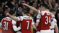 4. Black Panther (Arsenal) - Pada leg kedua babak 16 besar Liga Europa Aubameyang melakukan selebrasi ala Black Panther saat menjebol gawang Rennes. Selebrasi tersebut dilakukan pada gol kedua Auba. (AFP/Ian Kington)