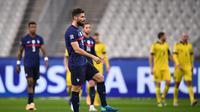 Striker Timnas Prancis, Olivier Giroud, berhasil mencetak dua gol dalam kemenangan 4-2 yang diraih Les Bleus atas Swedia di UEFA Nations League, Rabu (18/11/2020) dini hari WIB. (FRANCK FIFE / AFP)