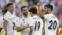 Marco Asensio (paling kanan) memberi kemenangan untuk Real Madrid (AP Photo/Nick Wass)