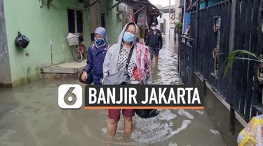 Sejumlah kawasan di Jakarta terendam banjir setelah diguyur hujan deras sejak hari Kamis. Sejumlah warga yang harus pergi bekerja terpaksa terobos genangan banjir hari Jumat (19/2) pagi.