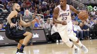 Jimmy Butler saat debut dengan Philadelphia 76ers  (AP Photo/John Raoux)