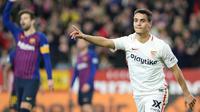 Wissam Ben Yedder merayak golnya ke gawang Barcelona. (AFP/Cristina Quicler)