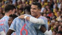 Cristiano Ronaldo merayakan gol yang dicetaknya saat Manchester United menghadapi Young Boys dalam laga matchday pertama Liga Champions 2021/2022, Rabu (15/9/2021) dini hari WIB. (SEBASTIEN BOZON / AFP)