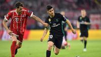 Gelandang Real Madrid asal Spanyol, Marco Asensio (kanan). (AFP/Christof Stache)