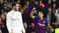 Luis Suarez mencetak tiga gol ke gawang Real Madrid. (AFP/Gabriel Bouys)