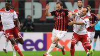AC Milan menghadapi Olympiakos pada laga kedua Grup F Liga Europa, di San Siro, Kamis (4/10/2018) malam WIB. (AFP/Miguel Medina)
