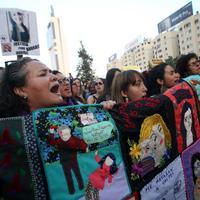 Perayaan International Wome's Day 2018 di Santiago. (CLAUDIO REYES / AFP)