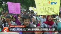 Aksi saling dorong antara petani dengan petugas Satpol PP ini terjadi setelah warga memaksa masuk kantor Bupati Langkat.