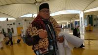 Ali Vickry, jemaah haji asal Sumenep yang membawa kain kafan. Liputan6.com/Nurmayanti