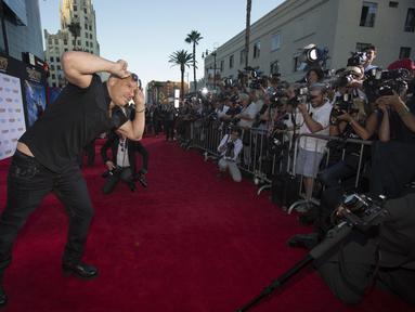 """Aktor Vin Diesel berpose di red carpet acara premiere """"Guardians Of The Galaxy"""" di  Hollywood, California, Selasa (22/7/14). (REUTERS/Mario Anzuoni)"""