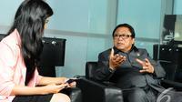 Wakil Ketua MPR RI Oesman Sapta Odang saat wawancara khusus di kantor Liputan6.com, Jakarta, Senin (15/12/2014). (Liputan6.com/Andrian M Tunay)
