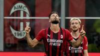 AC Milan berhasil menang telak atas tamunya Cagliari pada pekan kedua Liga Italia musim 2021/2022. Dua gol kemenangan Rossoneri dicetak oleh rekrutan anyar mereka pada musim ini, Olivier Giroud. (Foto: AP/Luca Bruno)