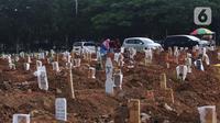 Suasana makam jenazah Covid-19 di TPU Tegal Alur, Jakarta, Minggu (3/12/2021). Pada peringkat kedua kasus harian tertinggi adalah Jawa Barat dengan total 1.167 kasus. (Liputan6.com/Angga Yuniar)