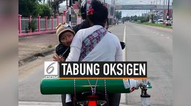Beredar di media sosial potret keluarga tumpangi motor dengan tabung oksigen. Di balik potret tersebut ada kisah haru perjuangan orang tua demi anaknya agar tetap hidup.