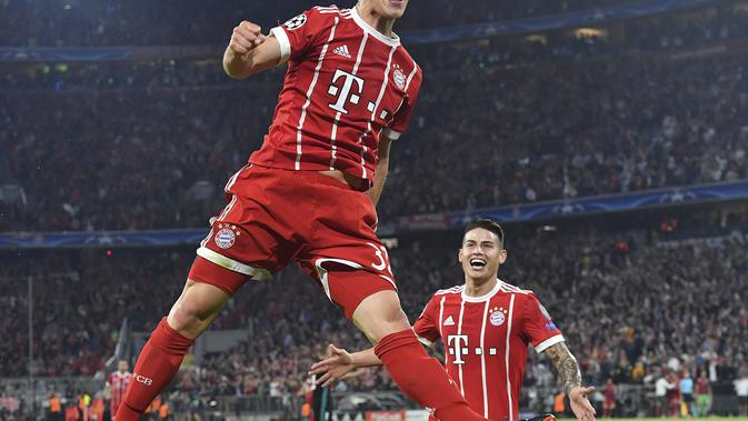 Selebrasi bek Bayern Munchen, Joshua Kimmich.(AP Photo/Kerstin Joensson)