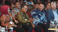 Menteri ESDM Arifin Tasrif (kedua kiri) bersama Direktur Utama PT Pertamina (Persero) Nicke Widyawati (kiri) dan Komisaris Utama Basuki Tjahaja Purnama menghadiri pembukaan Pertamina Energy Forum 2019 di Jakarta, Selasa (26/11/2019). (merdeka.com/Imam Buhori)