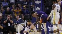 Stephen Curry cedera saat melawan Suns di lanjutan NBA (AP)