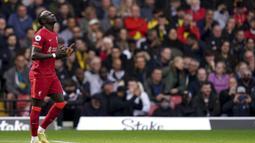 Liverpool sudah unggul 1-0 pada menit ke-9 melalui Sadio Mane. Tendangan kaki kanannya usai menerima umpan Mohamed Salah tak mampu diantisipasi kiper Watford, Ben Foster. (PA via AP/Tess Derry)