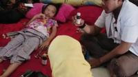 Salah seorang anak menjadi korban oenyakit misterius di Jeneponto (Fauzan/Liputan6.com)