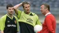 David Beckham dan Alex Ferguson (PATRICK HERTZOG / AFP)