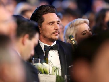 Aktor James Franco menghadiri acara penghargaan Screen Actors Guild (SAG) Awards di Los Angeles, Minggu (21/1). Ini adalah penampilan publik pertama Franco setelah tuduhan perilaku seksual yang dilayangkan padanya. (Christopher Polk/Getty Images/AFP)