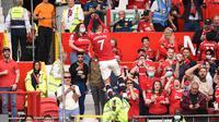 Cristiano Ronaldo saat mencetak gol ke gawang Newcastle United. (OLI SCARFF / AFP)