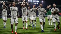Para pemain Juventus merayakan kemenangan atas Cagliari. (AFP/Marco Bertorello)