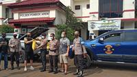 Polisi di Lingkungan Polsek Pondok Aren Terima Paket Sembako dari Komunitas Moge Jelang Ramadan. (Istimewa)