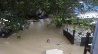 Topan Vamco di Pulau Luzon, Filipina, menyebabkan bencana banjir. Dok: AP Photo/Aaron Favila