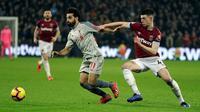 Winger Liverpool, Mohamed Salah, mendapat perlakuan rasial dari suporter West Ham United pada laga laga pekan ke-25 Premier League, di London Stadium, Senin (4/2/2019). (AP Photo/Kirsty Wigglesworth)