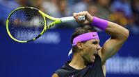 Ekspresi Rafael Nadal setelah menaklukkan petenis Italia, Matteo Berrettini, pada laga semifinal AS Terbuka 2019, Sabtu (7/9/2019) WIB. (AFP/Clive Brunskill)