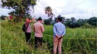 Polisi melakukan olah TKP penemuan jasad seoarang kapten kapal asal Manado. (Foto Istimewah)