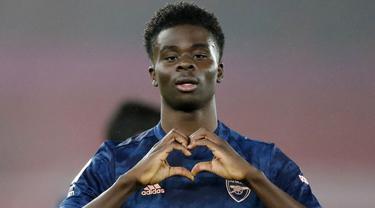 Bukayo Saka merupakan pemain Arsenal yang saat ini memiliki nilai banderol sebesar 65 juta euro. Dirinya tercatat mengalami kenaikan dari awal tahun 2021 sebanyak 40 juta euro. (Foto: AFP/Pool/Frank Augstein)