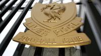 Logo dan ilustrasi Liverpool. (AFP/Paul Ellis)