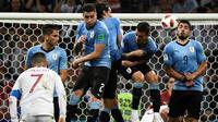 Timnas Uruguay menang 2-1 atas Portugal pada laga 16 besar Piala Dunia 2018, di Olimpiyskiy Stadion Fisht, Sabtu (30/6/2018) waktu setempat. (AFP/Jonathan Nackstrand)