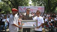 Sosok dibalik suksesnya Taman Suropati Chamber, pecahkan Rekor Dunia Konser dan memainkan lagu Indonesia Raya Orkestra. (foto: ©Kemenpora)