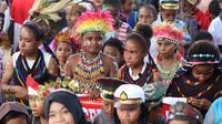 Konvoi merah putih di batas negara Papua dan Papua Nugini. (Liputan6.com/Katharina Janur/Humas Pemkot Jayapura)
