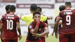 Pemain Borneo FC, Wildansyah melakukan selebrasi usai mencetak gol ke gawang Persita Tangerang dalam laga pekan ke-6 BRI Liga 1 2021/2022 di Stadion Pakansari, Bogor, Sabtu (10/2/2021). (Bola.com/M Iqbal Ichsan)