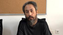Jurnalis Jepang Jumpei Yasuda (44) yang diculik di Suriah dihadirkan setelah pembebasannya di Hatay (24/10). Jumpei Yasuda dibebaskan setelah 40 bulan disekap oleh militan yang berafiliasi dengan al-Qaeda di Suriah. (AFP Photo/Behrouz Mehri)