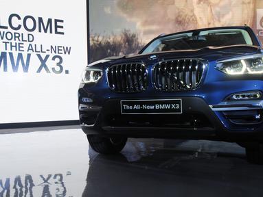 Penampakan BMW X3 terbaru saat peluncurannya di Jakarta, Rabu (11/4). Generasi ketiga BMW X3 ini dilengkapi dengan mesin empat silinder 2000 cc. (Merdeka.com/Dwi Narwoko)