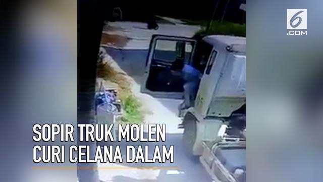 Aksi sopir truk molen mencuri celana dalam terekam kamera CCTV.