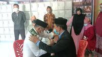 Ismail Suratinoyo saat melangsungkan pernikahan di dalam Lapas Kelas IIA Gorontalo (Arfandi Ibrahim/Liputan6.com)